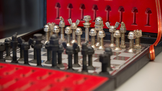 A chess set designed with bolts