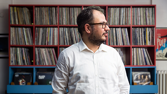 Murat Abbas with a section of his record collection