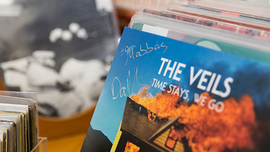 The album Time Stays, We Go by the Veils the band autographed for Abbas